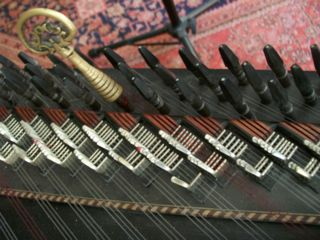 A qanûn, showing the levers used for tuning